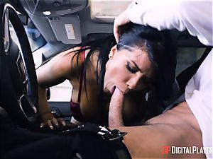 Romi Rain boinked in the back of the car