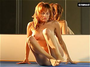 Mature red-haired does astounding stretches