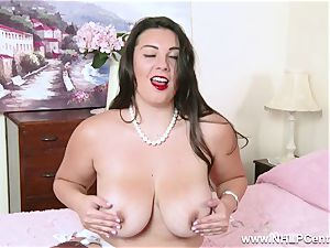 buxom dark-haired masturbates after sheer nylon underpants come off