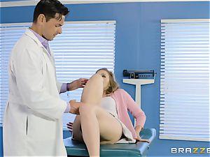 medic Ryan Driller pounds his patient Lena Paul