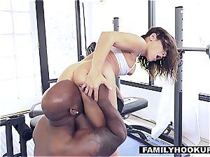 Abella rides her stepdaddys ebony penis
