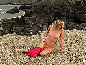 blond Tori getting naked