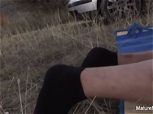 ash-blonde mature inhales and penetrates outdoors