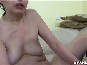 Mature grandmother loves to drill stiff with faux-cock